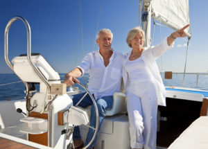 Retirement Planning Image with Retired Couple on Sailboat