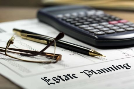 Estate Planning Paper, Calculator, Pen and Reading Glasses