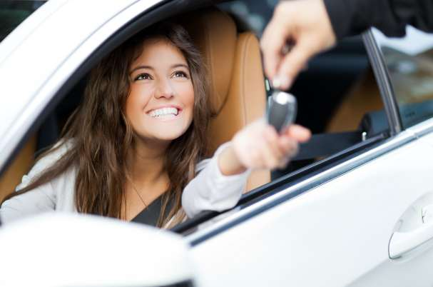 Purchasing a New Car With Woman Sitting in Car Taking Keys