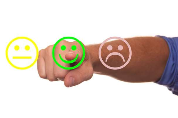 Online Reviews With man Selecting Happy Face