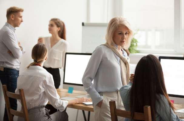 Planning Can Help With Business Woman Talking With Female Employee
