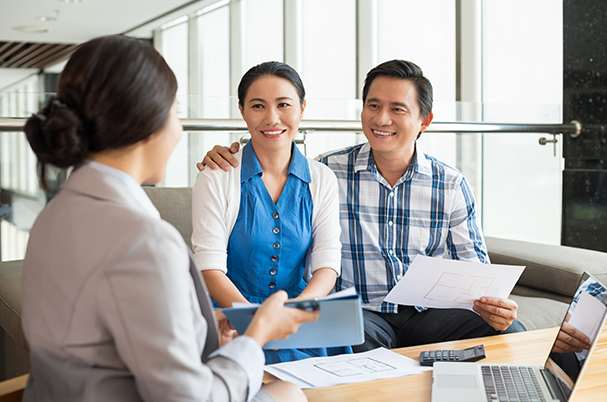 Everyone Needs an Estate Plan With Smiling Couple Meeting With Financial Planner