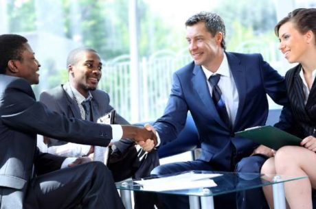 Business planning image with business people shaking hands at meeting