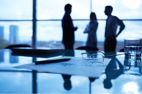 Excuses Business Owners Make With Group Standing in Conference Room
