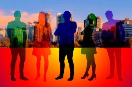 Knowing What You Need to Get What You Want Image Shows Colorful Silhouettes of Staff Standing in Front of a City