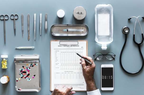 Healthcare Needs in Retirement Doctor's Clipboard, Shot and Pills