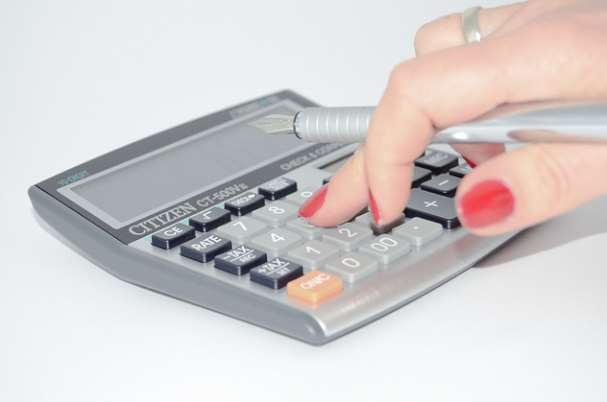Is Your 401(k) Accurate, Showing Calculations Being Made on Calculator