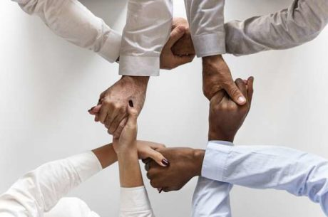 Why You'll Need an Advisor Team With Hands Intertwined in Circle