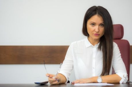 Incentivizing best employees image with business woman working at desk