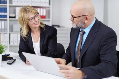 Knowing Your Business Value Image of male and female business people looking over documents