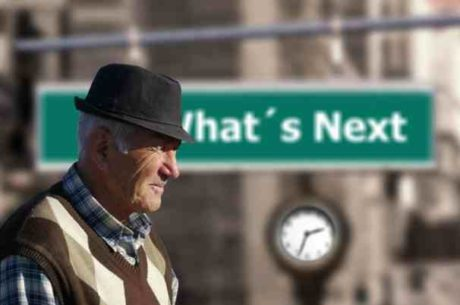 Transition into retirement depicting elderly man in front of what's next sign