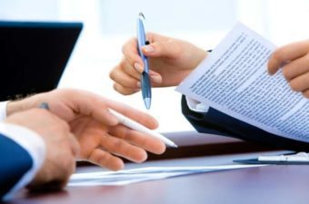 Buy Sell Agreement Shows Business People Discussing a Contract