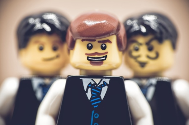Fairness and equity among family members depicts three male legos.