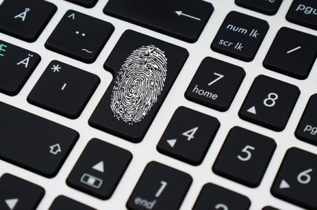 Hacked or spoofed image shows keyboard with fingerprint on a key