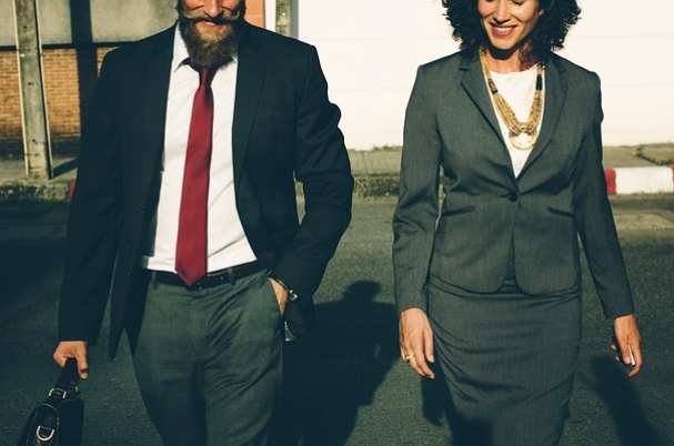 What you may get wrong about business valuation depicts business man and woman walking together.
