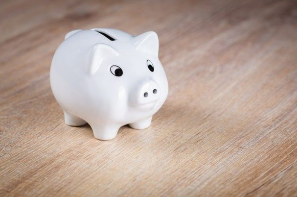 Compound interest depicts white piggy bank on table.