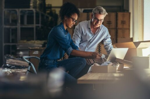 Financial planning for small business owners shows man and woman working in warehouse