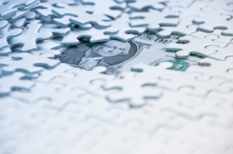 Cost Benefits of Financial Planning: Missing Pieces in a Puzzle Expose a Dollar Bill